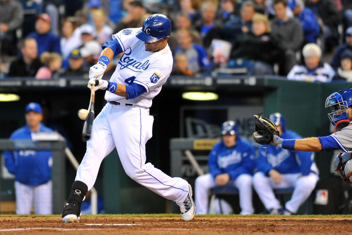 April 20, 2012; Kansas City, MO, USA; Kansas City Royals left fielder Alex Gordon (4) connects for a double in the third inning of the game against the Toronto Blue Jays at Kauffman Stadium. Mandatory Credit: Denny Medley-US PRESSWIRE