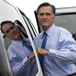 In this Aug. 18, 2012 file photo, Republican presidential candidate, former Massachusetts Gov. Mitt Romney gets into his car to attend a fundraising event in Nantucket, Mass.