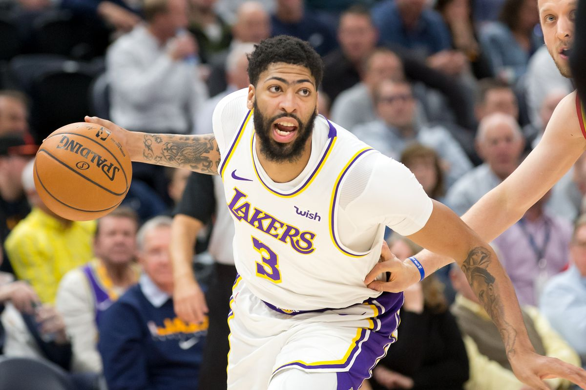 Los Angeles Lakers forward Anthony Davis dribbles the ball during the first quarter against the Utah Jazz at Vivint Smart Home Arena.