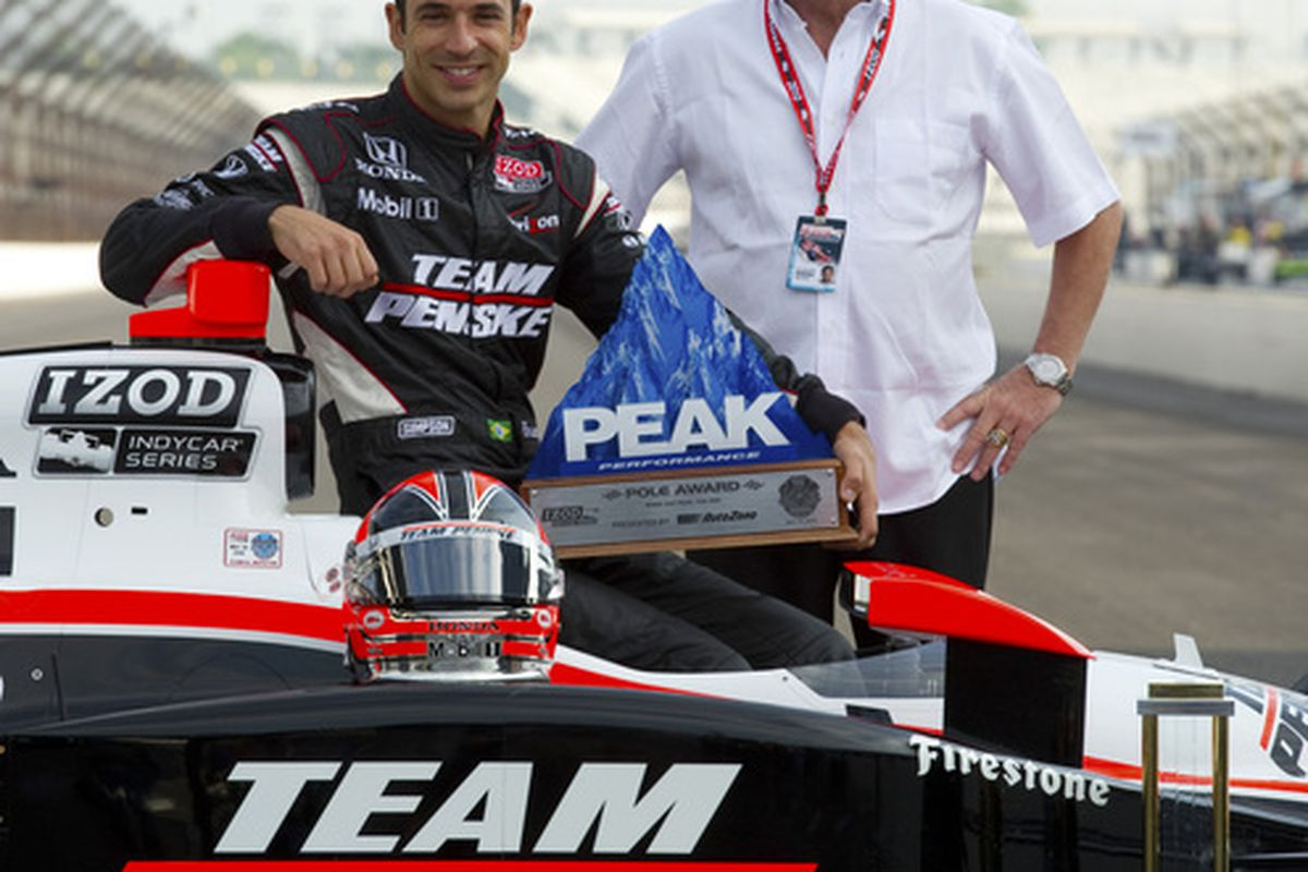 Helio Castroneves poses on the front stretch with his father Helio Castroneves after earning pole position for the 94th running of the Indianapolis 500 (Photo by Robert Laberge/Getty Images)