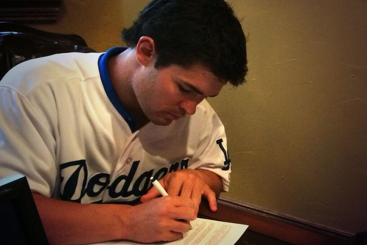 Hunter Redman signed his first professional contract on Wednesday.