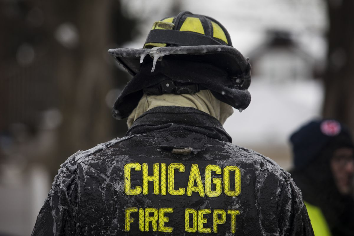 Chicago firefighter on the scene of house fire in Belmont Cragin in January 2019.