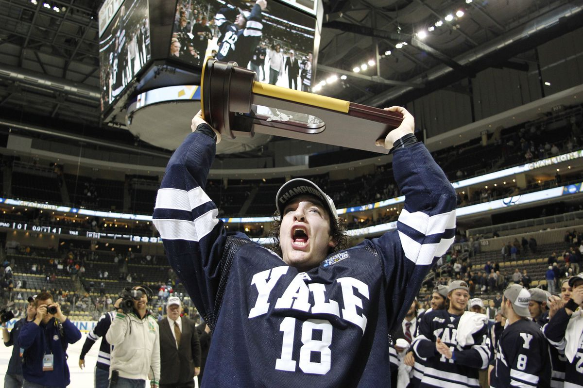 Yale senior Kenny Agostino holds up the NCAA Championship trophy after last season's Frozen Four title game win over Quinnipiac.