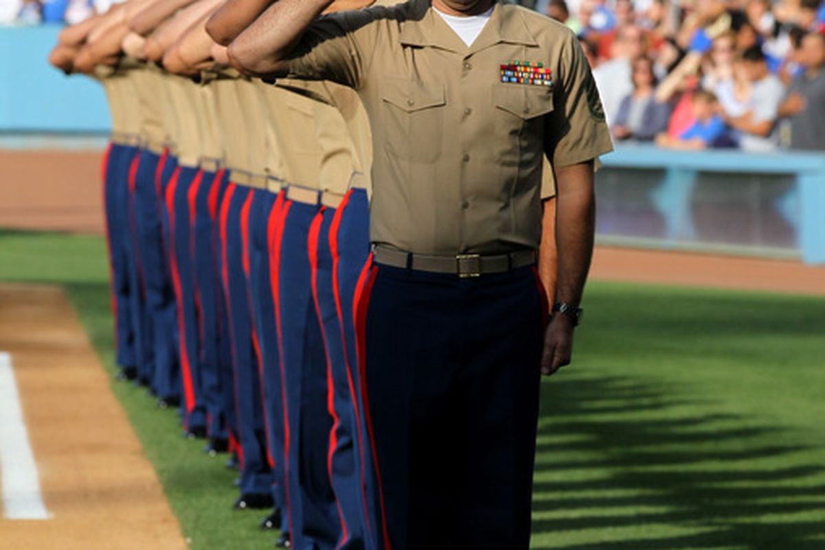 These members of the U.S. Marine Corps - saluting during the national anthem - looked much sharper than John Ely did tonight.