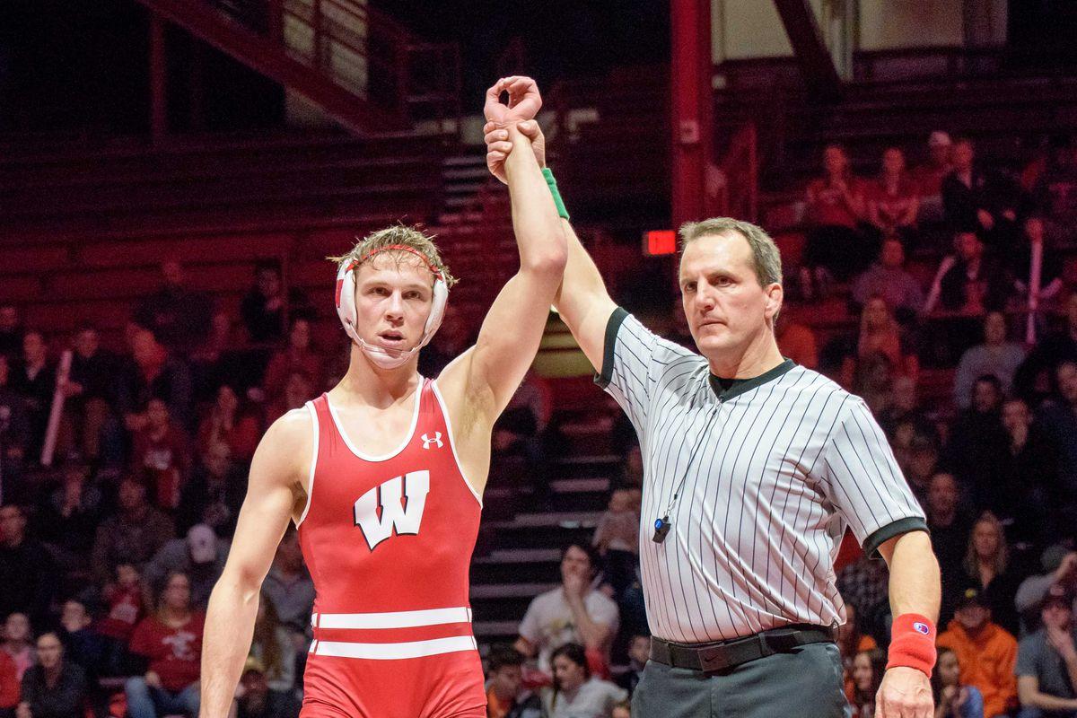 Evan Wick Wisconsin wrestling victory pose