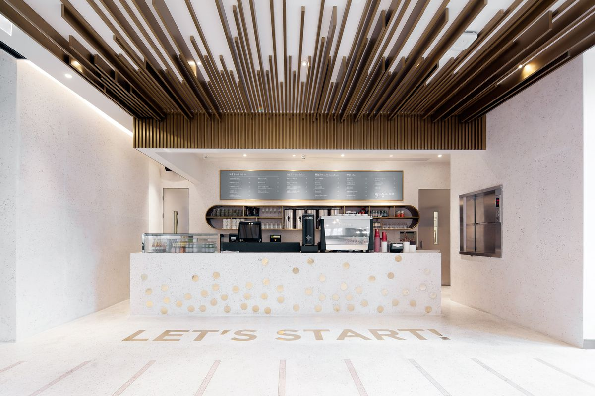 Coffee bar with white tile floor
