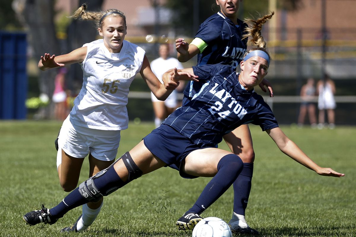 Layton's Sydney Barlow (24) and Davis' Annie Haycock (55) compete for the ball at Layton High School in Layton on Thursday, Aug. 27, 2020.