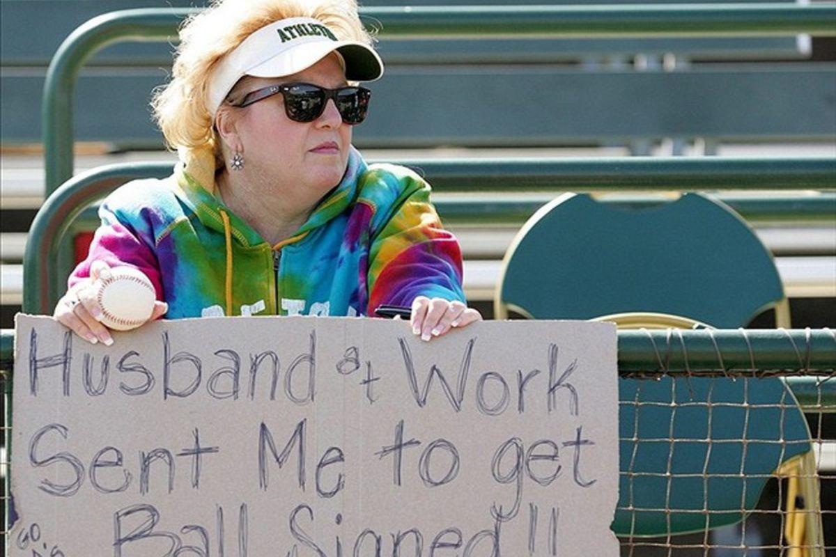 Mar 7, 2012; Phoenix, AZ, USA; Oakland Athletics fan Terry Ammirati holds up a sign before a game against the Los Angeles Dodgers at Phoenix Municipal Stadium.  Mandatory Credit: Jake Roth-US PRESSWIRE