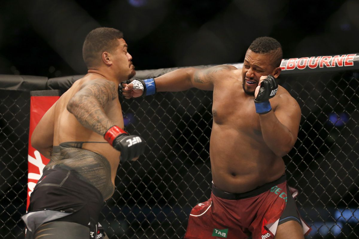 Yorgan De Castro of Cape Verde knocks out Justin Tafa of New Zealand in their Heavyweight bout during UFC 243 at Marvel Stadium on October 06, 2019 in Melbourne, Australia.