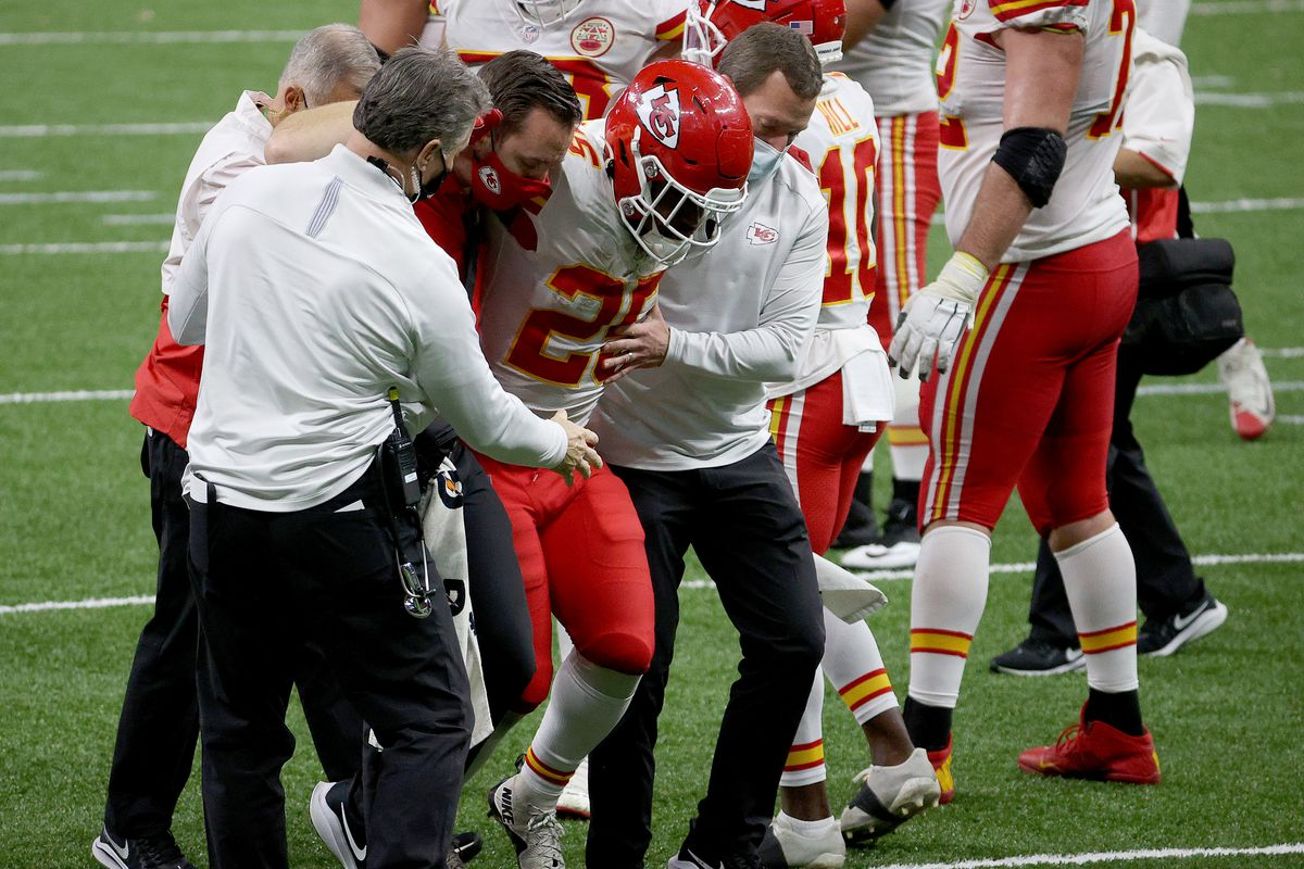 Clyde Edwards-Helaire #25 of the Kansas City Chiefs is carried off the field by medical staff against the New Orleans Saints during the fourth quarter in the game at Mercedes-Benz Superdome on December 20, 2020 in New Orleans, Louisiana.