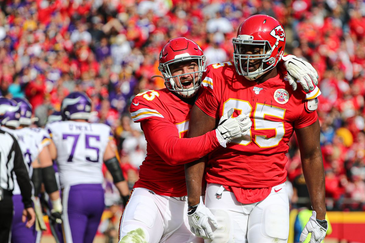 Kansas City Chiefs defensive end Chris Jones is congratulated by defensive tackle Joey Ivie after a sack against the Minnesota Vikings during the first half at Arrowhead Stadium.