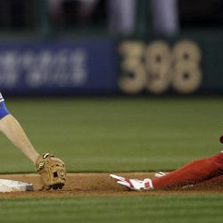 Philadelphia Phillies' John Mayberry Jr., right, is caught by New York Mets second baseman Daniel Murphy while trying to stretch a single in the second inning of a baseball game on Friday, April 13, 2012, in Philadelphia.