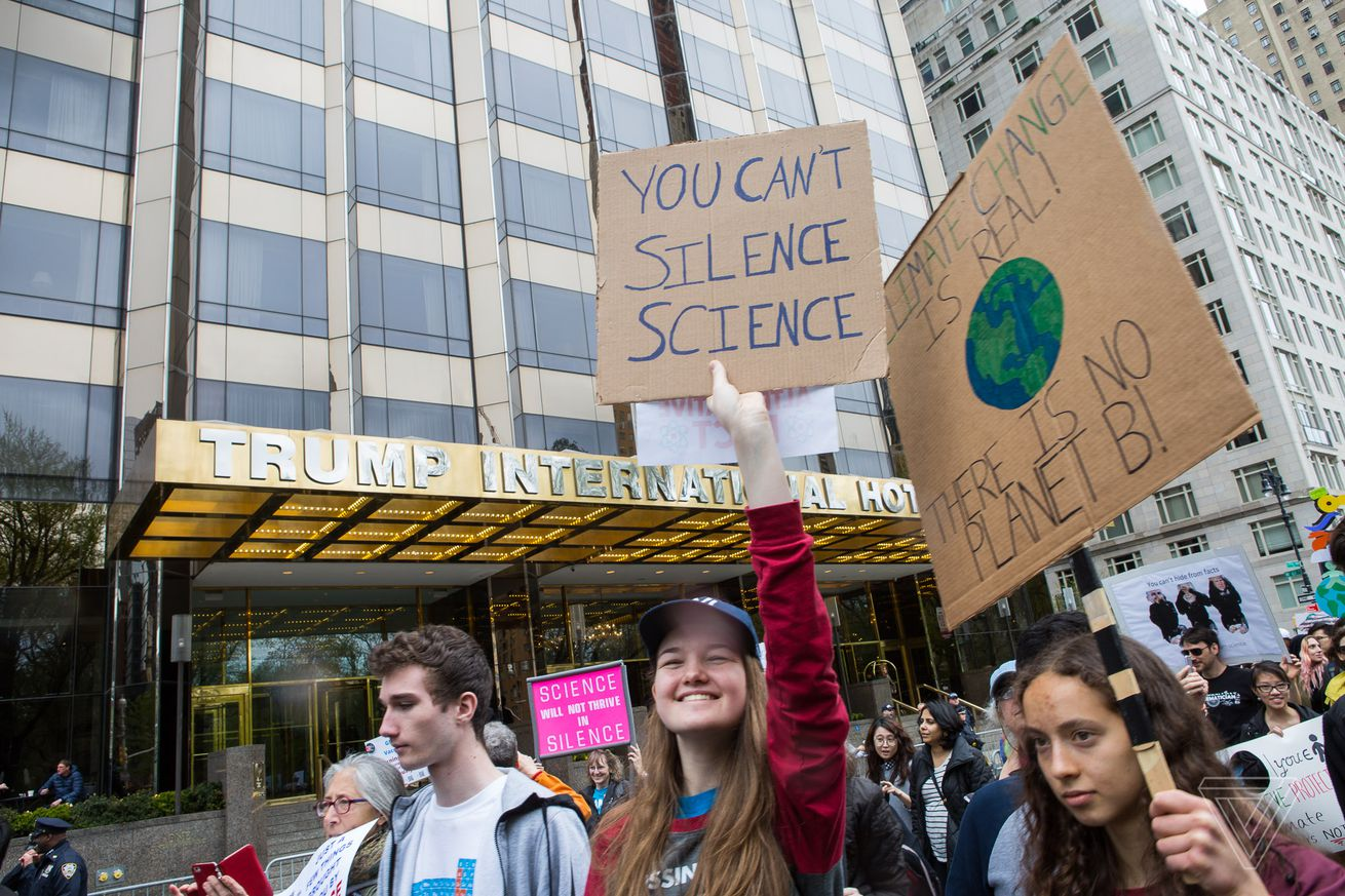 <em>People holding signs at last year's March for Science.</em>