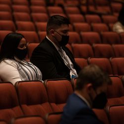 Masked attendees bow as they pray at the start of Saturday evening session of the 191st Semiannual General Conference of The Church of Jesus Christ of Latter-day Saints at the Conference Center in Salt Lake City on Saturday, Oct. 2, 2021.