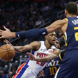 Detroit Pistons guard Brandon Knight (20) passes the ball against Utah Jazz guard Mike Conley (10) and center Rudy Gobert (27) during the first half of an NBA basketball game Saturday, March 7, 2020, in Detroit.