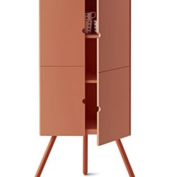 A corner cabinet standing on three legs so no drilling is required.