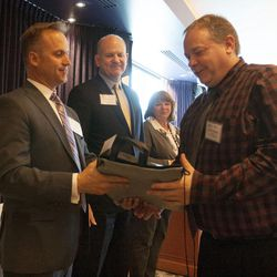 David Starling, Provo City School District business teacher, receives an award for his students at The Stock Market Game student awards banquet in Salt Lake City on Friday, May, 13, 2016. Starling's team of seven students won first place in the high school division of the competition.