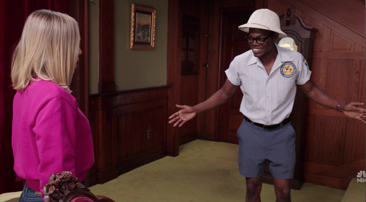 Eleanor looking at Chidi wearing a tight mailman outfit