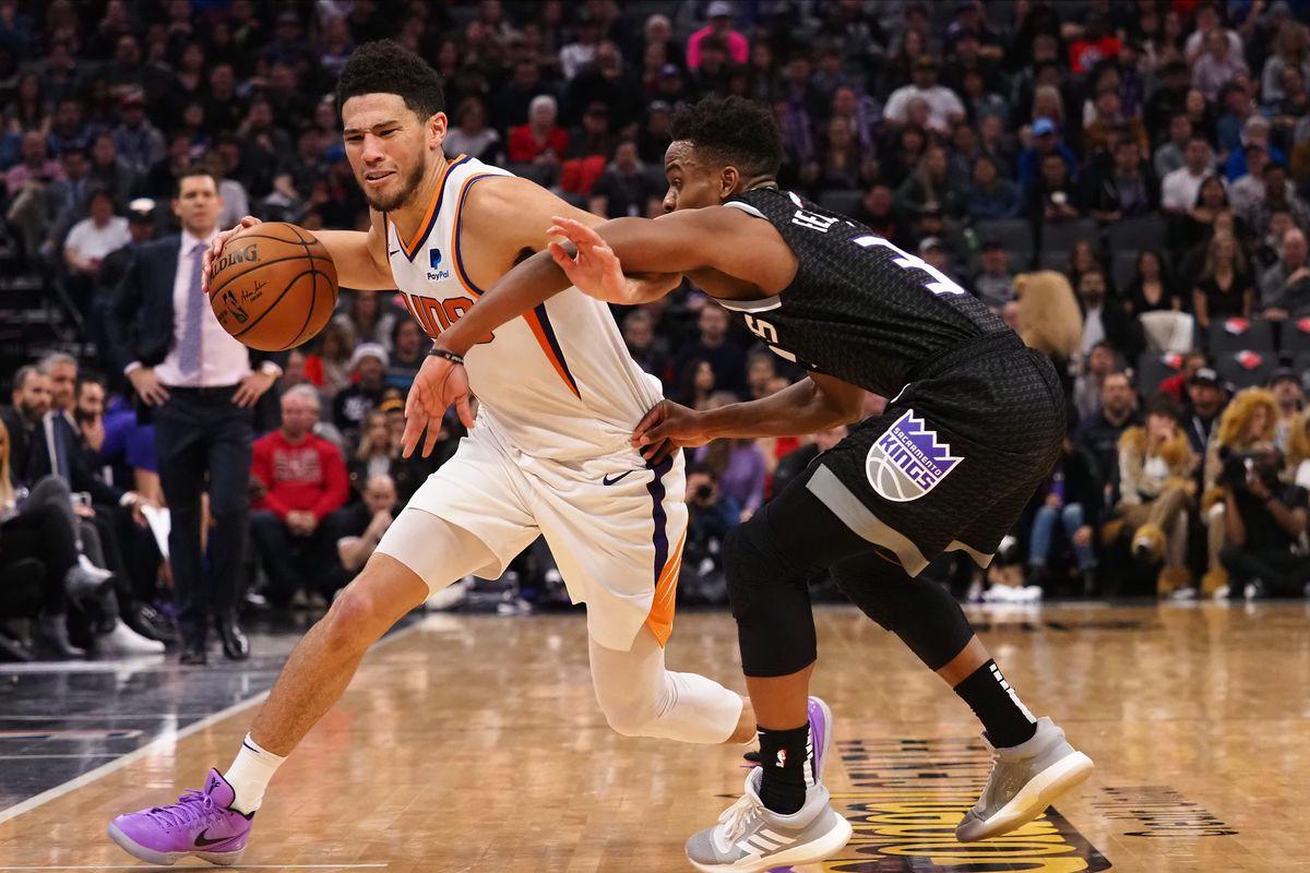 Phoenix Suns guard Devin Booker controls the ball against Sacramento Kings guard Yogi Ferrell during the fourth quarter at Golden 1 Center.
