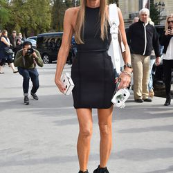 Image via Getty. Sunglasses, dress, and shoes by Alexander Wang x H&M.