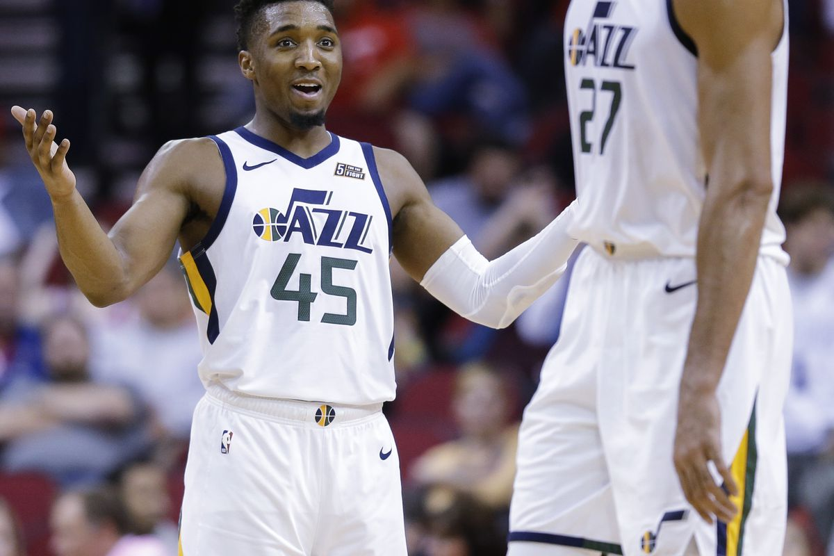 Utah Jazz guard Donovan Mitchell (45) gestures towards Rudy Robert following the team's win against the Houston Rockets in an NBA basketball game, Wednesday, Oct. 24, 2018, In Houston. Utah won 100-89. (AP Photo/Eric Christian Smith)
