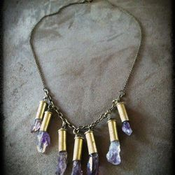 """Bullet casing and amethyst necklace ($45) from Philly's own <a href=""""https://www.facebook.com/pages/Sultana-Aschim-Jewelry/173265428756"""">Sultana Aschim Jewelry</a>."""