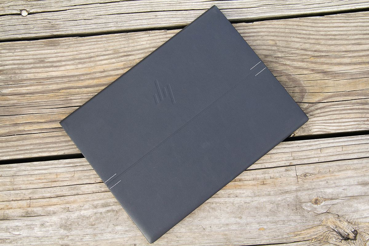 The HP Elite Folio closed on a wooden deck seen from above.