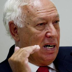 Spain's Foreign Minister Jose Manuel Garcia Margallo speaks during a news conference in Madrid Monday Sept. 3, 2012. Spain says 160 migrants rushed fences guarding one of its north African enclaves on Monday Sept. 3, 2012 and the county's Foreign Minister Jose Manuel Garcia Margallo raised concerns more may swarm to Spanish islands just off Morocco's northern coast. Migrants tried to breach two sections of fences that act as a border between Melilla and Morocco early Monday, with about 10 succeeding in entering Spanish territory, officials said. Some 70 illegal immigrants reached the tiny uninhabited island of Isla de Tierra off Morocco, joining another 19 who reached the archipelago last Wednesday.