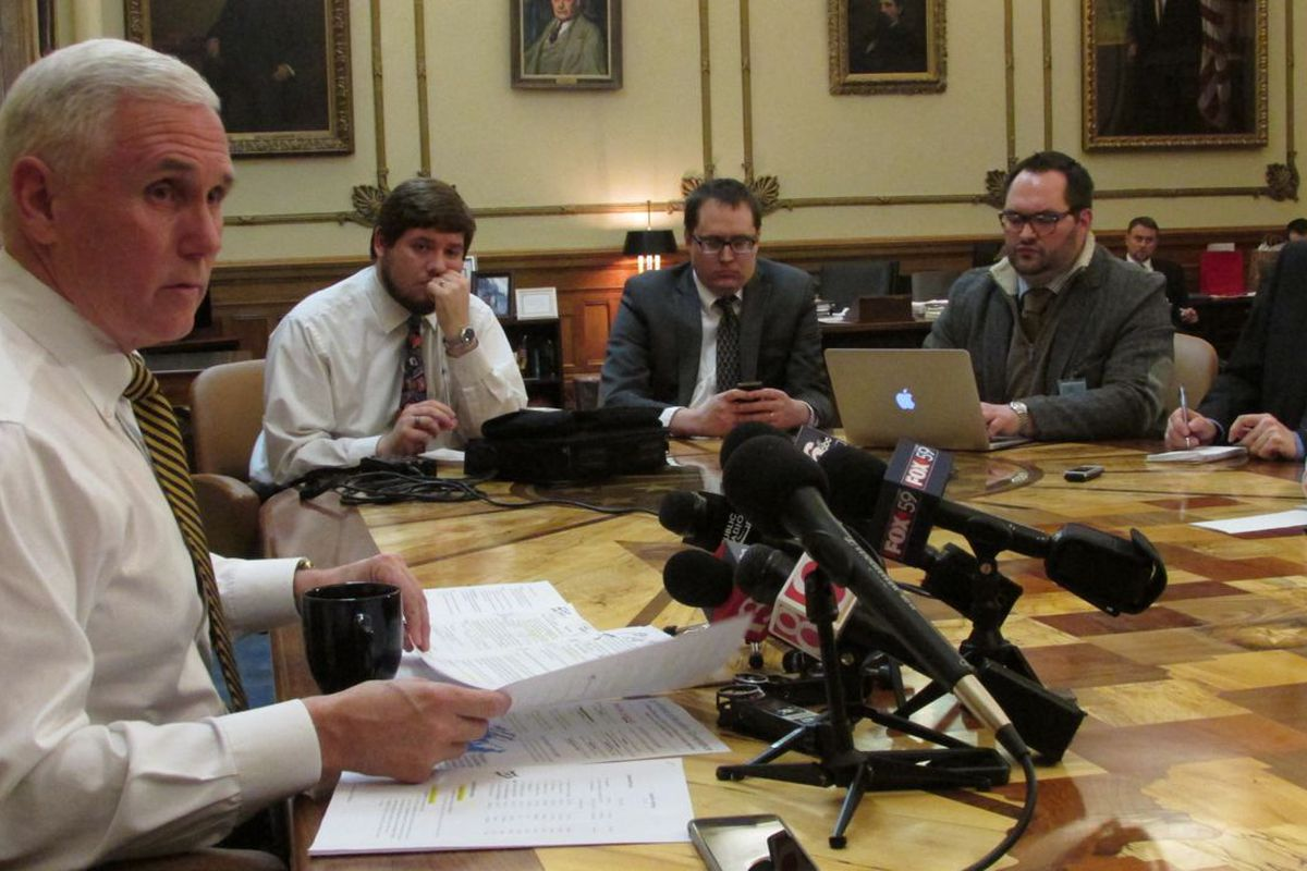 Gov. Mike Pence speaks with reporters about ISTEP in his office last week.
