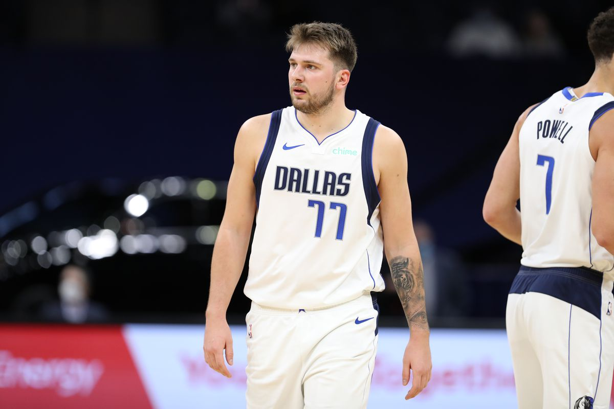 Luka Doncic of the Dallas Mavericks looks on during the game against the Minnesota Timberwolves on March 24, 2021 at Target Center in Minneapolis, Minnesota.
