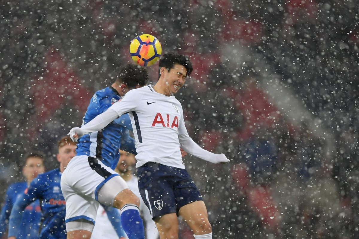 Son fires Spurs to 2-0 win over Huddersfield