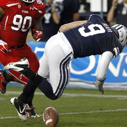 Brigham Young Cougars quarterback Jake Heaps (9) loses the ball and Utah scores as the University of Utah and Brigham Young University play football Saturday, Sept. 17, 2011, in Provo, Utah.