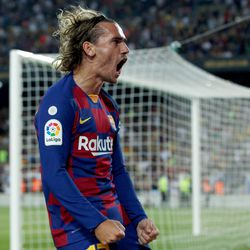 Antoine Griezmann celebrates his first goal for Barcelona in a 5-2 win over Real Betis