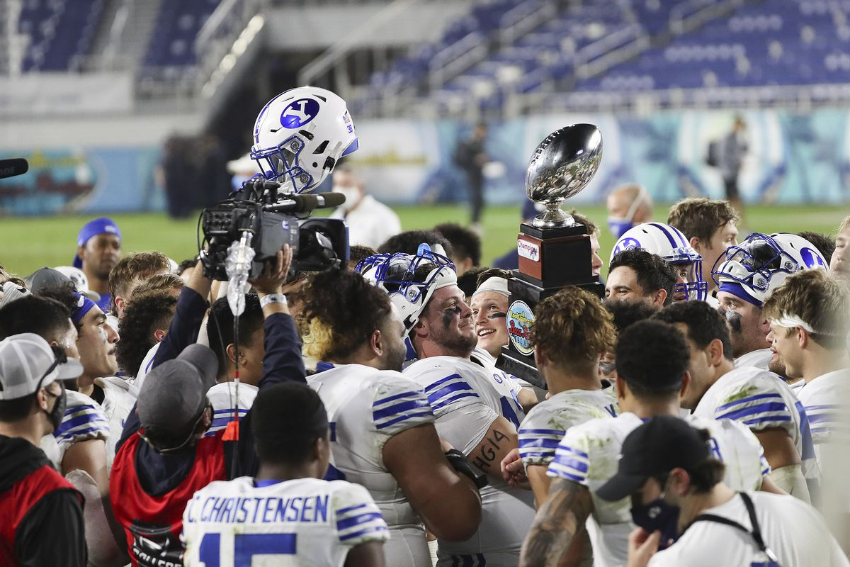 BYU Cougars react as they hoist the trophy after winning the Boca Raton Bowl in Boca Raton, Fla., on Tuesday, Dec. 22, 2020.