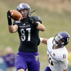 Weber State Wildcats tight end Andrew Vollert (87) makes a one-handed catch over the middle ahead of Western Illinois Leathernecks defensive back Eric Carrera (11) as Weber State and Western Illinois play at Stewart Stadium in Ogden, Utah, on Saturday, Nov. 25, 2017.