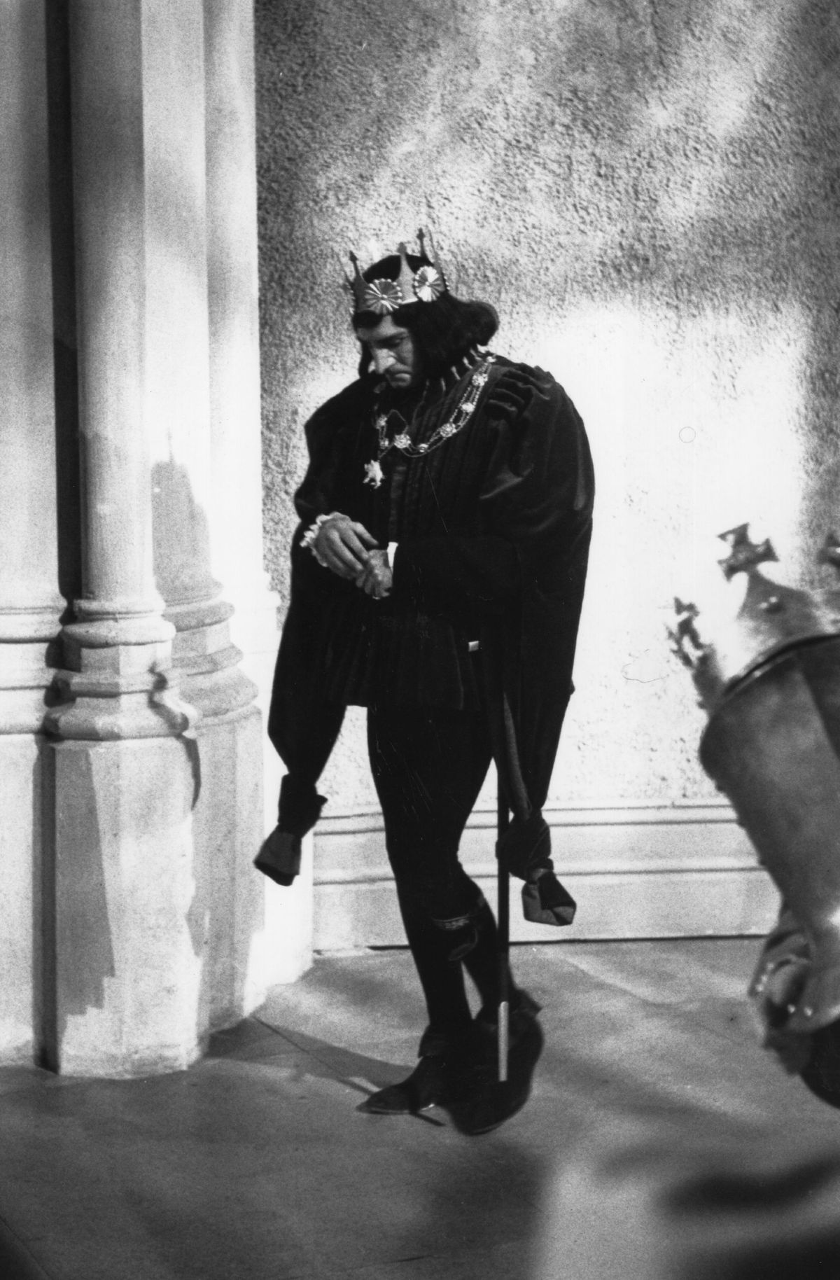 Laurence Olivier, dressed as King Richard III, stands alone.