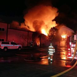 Crews battle a blaze at the Public Works Building in Sandy on Friday, Jan. 27, 2017.