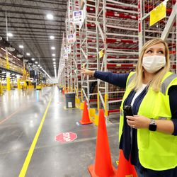 Anne Laughlin, with Amazon public relations, describes how the process works at the company's newly opened fulfillment center in West Jordan on Monday, Sept. 14, 2020.
