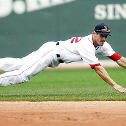 Boston Red Sox's Nick Green dives and misses a single by Detroit Tigers' Adam Everett in the seventh inning Thursday.