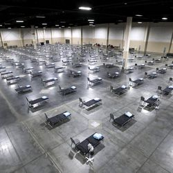 Beds and chairs are pictured in the Mountain America Expo Center in Sandy on Monday, April 6, 2020. The state contracted with Salt Lake County to use the expo center as a hospital overflow facility for people needing hospital care that's not related to COVID-19 should the need arise during the pandemic.