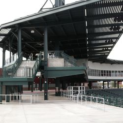 Stairs to upper-level party area behind first base