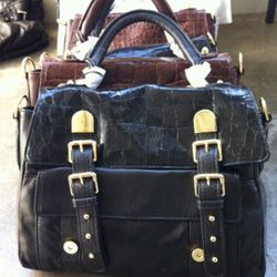 These buckle satchels come in black and brown are priced at $175