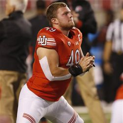 Utah defensive end Hunter Dimick (49) warms up before the start of an NCAA college football game, Saturday, Oct. 8, 2016, in Salt Lake City. (AP Photo/George Frey)