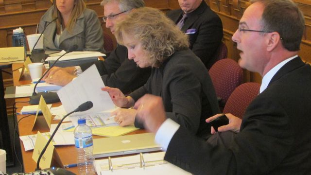 State Superintendent Glenda Ritz (center) and committee member Steve Baker (foreground) shared ideas at Monday's A to F accountability panel.