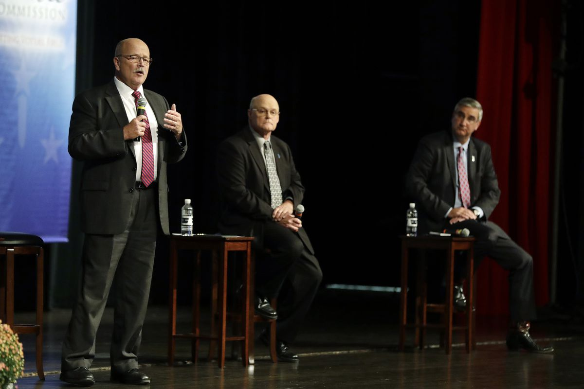 Democrat John Gregg, left,  responds to a question during a debate for Indiana Governor, Tuesday, Sept. 27, 2016, in Indianapolis. Libertarian Rex Bell and Republican Lt. Gov. Eric Holcomb also participated in the debate.