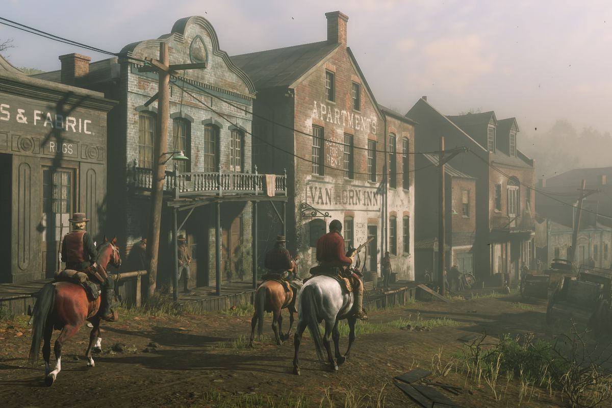 Red Dead Online - three people riding down the main drag of Van Horn Trading Post