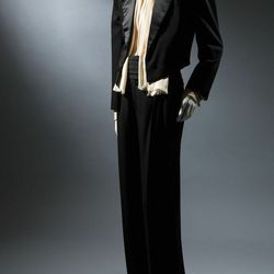 """""""When [the Le Smoking tuxedo] came out, it was considered quite shocking. It first debuted in 1966, and this is not the original version, it's a later version. Like his 1940's collection, when it first came out, people did not understand it, but it then w"""
