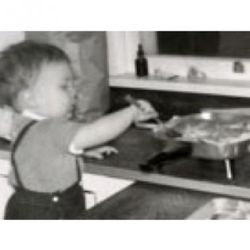 <b>Mario Batali</b>: There was a brief period in 1964 when Batali didn't have an orange ponytail (his hair wasn't long enough).  Sadly, this photo doesn't show baby Joe Bastianich, who was at the kitchen table that day, fiddling around with an abacus and