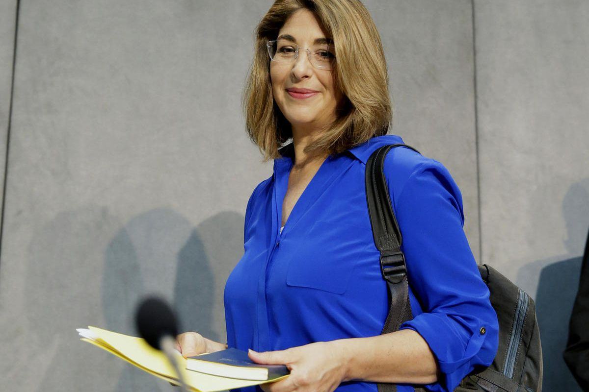 FILE - In this July 1, 2015 file photo, Naomi Klein arrives for a news conference at the Vatican. Klein, along with Carlos Santana and Marlon James, are among the winners of the 36th annual American Book Awards, which celebrate diversity in publishing. Kl