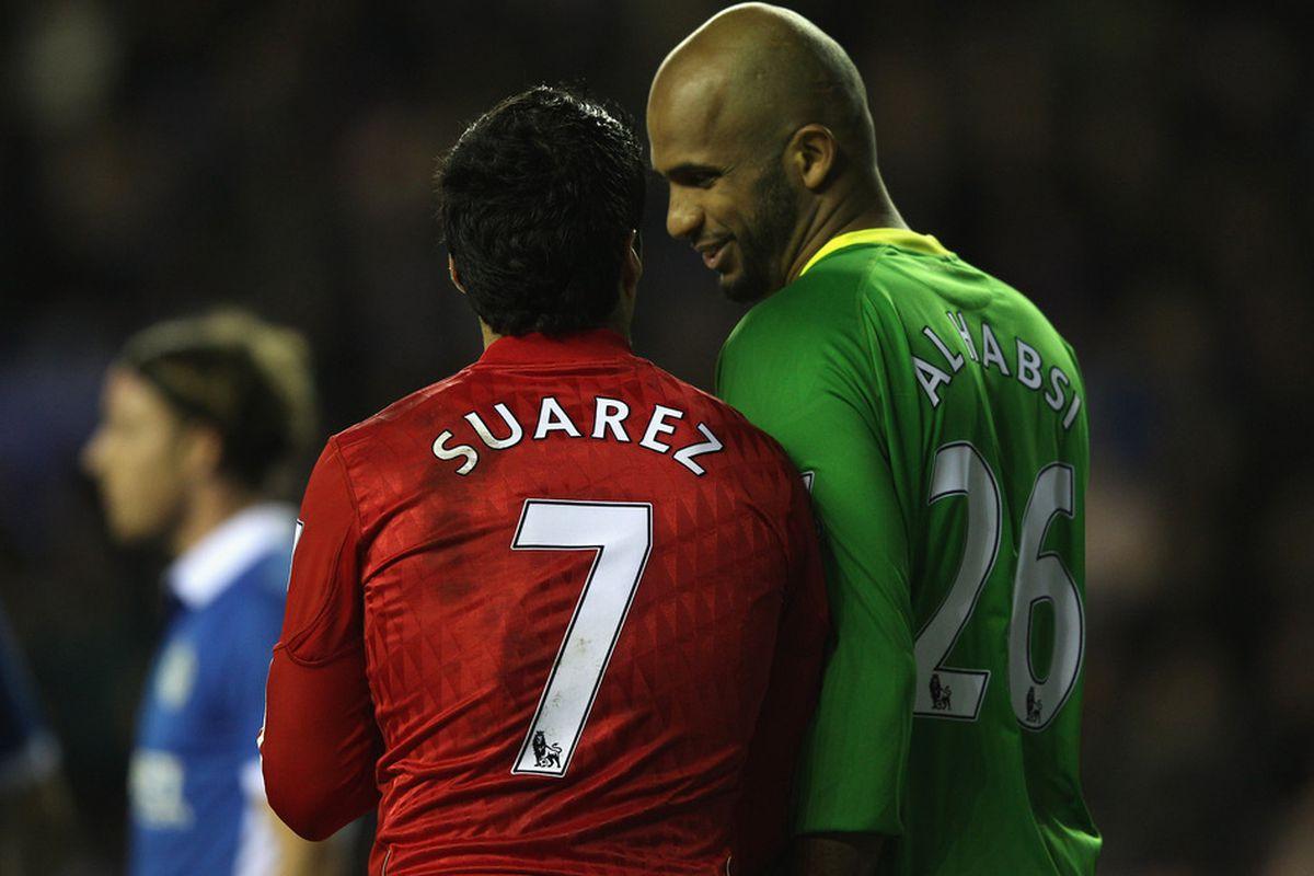 Ali Al Habsi (R) of Wigan Athletic and Luis Suarez (L) of Liverpool during the Barclays Premier League match between Wigan Athletic and Liverpool at the DW Stadium.